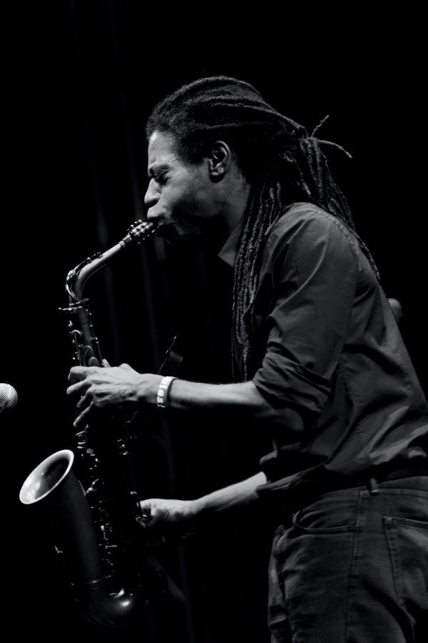 monochrome photo of man playing saxophone 1813157
